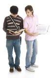 Los dos estudiantes jovenes aislados en un blanco Imágenes de archivo libres de regalías