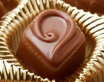 Los dulces del chocolate se cierran para arriba Imagen de archivo
