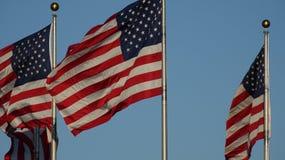 Los E.E.U.U. señalan los Estados Unidos de América por medio de una bandera Fotografía de archivo