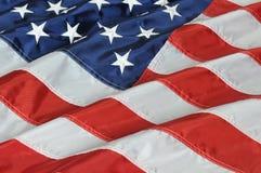Los E.E.U.U. señalan por medio de una bandera cerca para arriba Imagenes de archivo