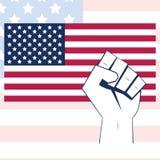 Los E.E.U.U. señalan por medio de una bandera con el puño Imagen de archivo libre de regalías