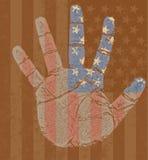 Los E.E.U.U. señalan por medio de una bandera en mi mano Foto de archivo