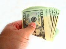 Los E.E.U.U. veinte cuentas y mano de dólar Foto de archivo