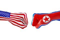 Los E.E.U.U. y bandera de Corea del Norte  Lucha del concepto, competencia del negocio, conflicto o eventos que se divierten Imagen de archivo libre de regalías