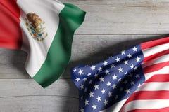 Los E.E.U.U. y banderas de México Imagenes de archivo