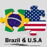 Los E.E.U.U. y banderas del Brasil en rompecabezas Foto de archivo
