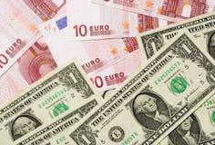 Los E.E.U.U. y dinero en circulación euro Imágenes de archivo libres de regalías