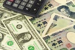Los E.E.U.U. y pares japoneses del dinero en circulación Imágenes de archivo libres de regalías