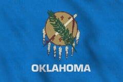 Los E.E.U.U. señalan por medio de una bandera de Oklahoma que agita suavemente en el viento stock de ilustración