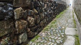 Los edificios tradicionales de piedra de la travesía de camino Imagenes de archivo