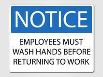 Los empleados deben lavar las manos firman en un fondo gris Fotos de archivo