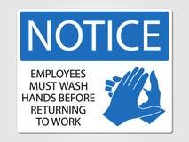 Los empleados lavan las manos firman en un fondo gris Fotografía de archivo