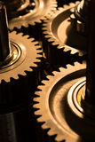 Los engranajes del metal se cierran para arriba Imágenes de archivo libres de regalías