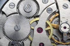 Los engranajes viejos del reloj se cierran para arriba Fotos de archivo libres de regalías
