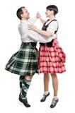 Los escoceses de baile de la mujer y del hombre de los pares bailan Fotos de archivo