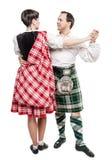 Los escoceses de baile de la mujer y del hombre de los pares bailan Imágenes de archivo libres de regalías