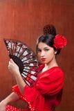 Los españoles gitanos de la rosa del rojo de la mujer del bailarín del flamenco avivan Fotos de archivo libres de regalías