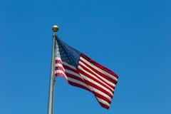 Los Estados Unidos señalan por medio de una bandera Foto de archivo