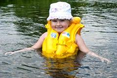 Los estudios del niño a flotar Imagen de archivo
