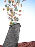 Los euros vuelan abajo de la chimenea Imagenes de archivo