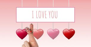 Los fingeres de la tarjeta del día de San Valentín aman los pares y te amo el texto y los corazones burbujeantes de las tarjetas  Imagen de archivo
