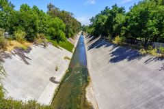 Los Gatos creek running low on a hot summer day, south San Francisco bay area, California royalty free stock images