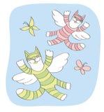 Los gatos y las mariposas vuelan en el cielo Fotografía de archivo libre de regalías