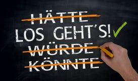 Los geht`s, haette, wuerde, koennte in german Let`s go, could,. Should; would written by hand on blackboard Royalty Free Stock Photo