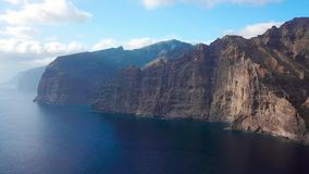 Los Gigantes Cliffs on Tenerife, Aerial View. Aerial View of Los Gigantes Cliffs on Tenerife, Canary Islands, Spain stock video footage