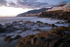 Los Gigantes Rocks. In the evening with smoke effect on the water Stock Photography