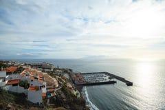 Los Gigantes sea port, Tenerife, Canary Islands, Spain. La Gomera on back ground. Residential apartments with sea port of Los Gigantes in the background royalty free stock image
