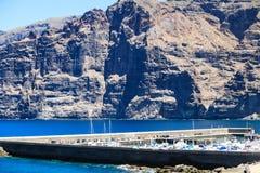 Los Gigantes sea port, Tenerife, Canary Islands, Spain. La Gomera on back ground. Residential apartments with sea port of Los Gigantes in the background stock image
