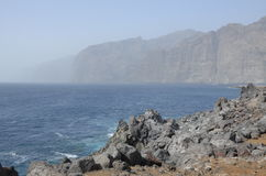 Los Gigantes shrouded in fog, Tenerife, Spain. Royalty Free Stock Images