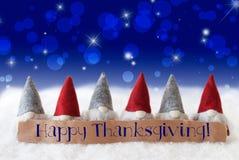 Los gnomos, fondo azul, Bokeh, estrellas, mandan un SMS a acción de gracias feliz Fotos de archivo