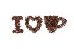 Los granos de café asados en la forma de alfabetos, amo el café Fotografía de archivo libre de regalías
