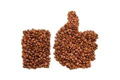 Los granos de café manosean con los dedos para arriba Fotos de archivo