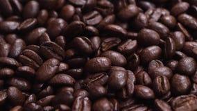 Los granos de café texturizan la cámara lenta almacen de video
