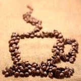 Los granos de cafés Foto de archivo