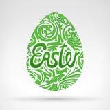 Los gráficos verdes del huevo de Pascua del follaje diseñaron con el texto Foto de archivo libre de regalías