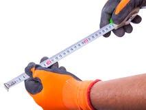 Los guantes masculinos del trabajo de manos guardan la ruleta Imagen de archivo libre de regalías
