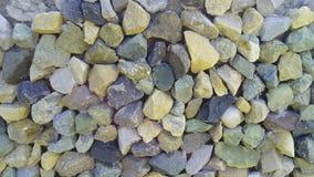 Los guijarros de las piedras cubren con grava piedras machacadas foto de archivo