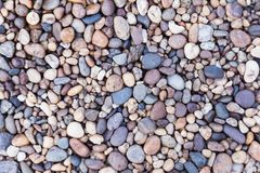 Los guijarros de piedra texturizan o empiedran el fondo de los guijarros para el diseño Fotografía de archivo