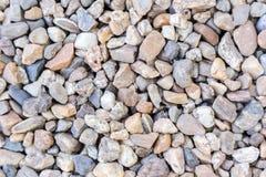 Los guijarros de piedra texturizan o empiedran el fondo de los guijarros para el diseño Imagen de archivo