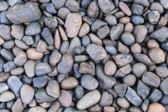 Los guijarros de piedra texturizan o empiedran el fondo de los guijarros para el diseño Fotos de archivo