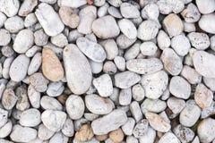 Los guijarros de piedra texturizan o empiedran el fondo de los guijarros para el diseño Imagen de archivo libre de regalías