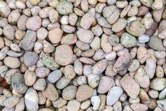 Los guijarros de piedra texturizan o empiedran el fondo de los guijarros para el diseño Fotos de archivo libres de regalías
