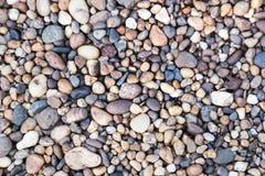 Los guijarros de piedra texturizan o empiedran el fondo de los guijarros para el diseño Fotografía de archivo libre de regalías