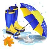 los gumboots Azul-amarillos, paraguas de los niños, naranja que cae se van foto de archivo libre de regalías