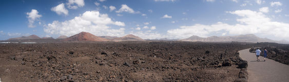 Los Hervideros. Is a barren volcanic park area on the southeast of Lanzarote ringed by dormant volcanoes abutting the atlantic ocean Stock Photos