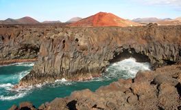 Los Hervideros, Lanzarote. Los Hervideros, streams of volcanic lava pouring into sea, Lanzarote, Canary Islands Stock Image